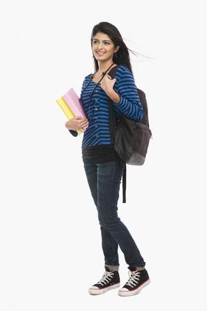 shoulder bag: Female university student holding books