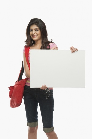 Woman holding a blank placard Stock Photo - 10166887