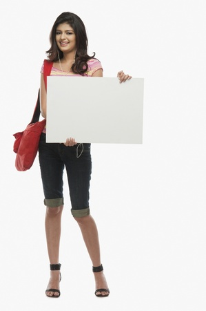 Woman holding a blank placard Stock Photo - 10168695