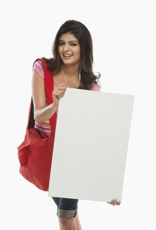 Woman holding a blank placard Stock Photo - 10166949