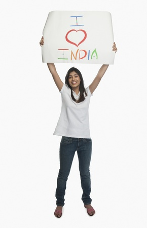 arms raised: Woman holding a placard with text I Love India written on it