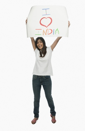 message: Woman holding a placard with text I Love India written on it