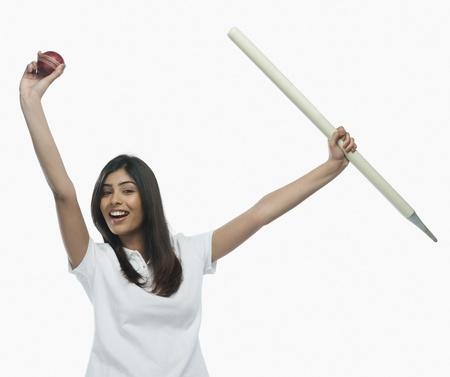Portrait of a female cricket fan cheering Stock Photo - 10166762