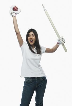 Portrait of a female cricket fan cheering Imagens