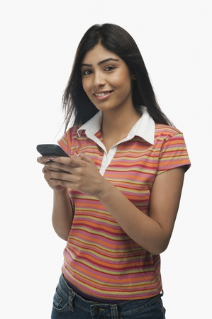 Portrait of a woman text messaging on a mobile phone Stock Photo - 10167508