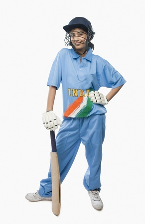 Portrait of a female cricketer standing with a cricket bat Stock Photo - 10168875