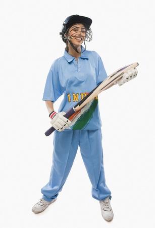 cricket bat: Close-up of a female cricketer holding a cricket bat LANG_EVOIMAGES