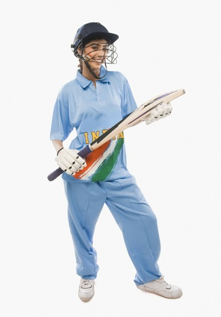 cricketer: Portrait of a female cricketer holding a cricket bat LANG_EVOIMAGES