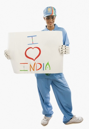 Woman in cricket uniform holding a placard with text I Love India written on it Stock Photo - 10166833