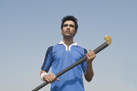 Man die een hockeystick
