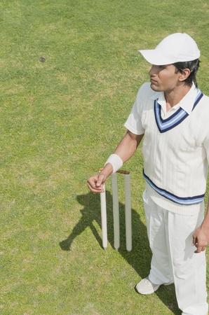 wicket: Cricket player near wicket