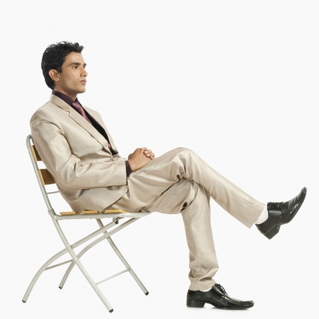 Businessman sitting on a chair Stock Photo - 10166906