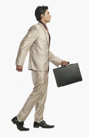 walking path: Businessman holding a briefcase