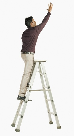 Businessman on a ladder