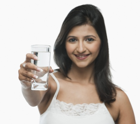 Portrait of a woman holding a glass of water