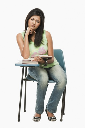 University student thinking in a classroom Stock Photo - 10167147