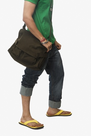 low section view: Low section view of a university student carrying a bag