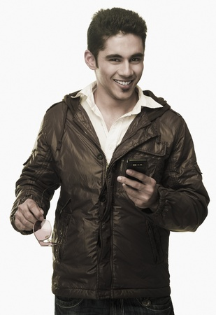 clipping  messaging: Portrait of a man text messaging on a mobile phone