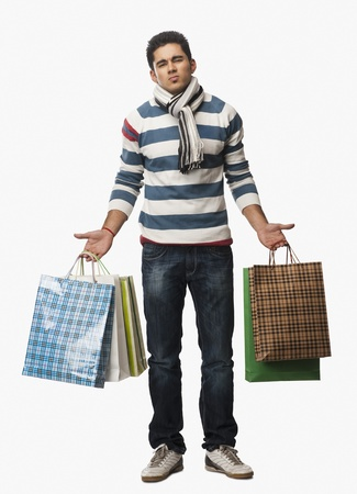 man shopping: Portrait of a man carrying shopping bags LANG_EVOIMAGES