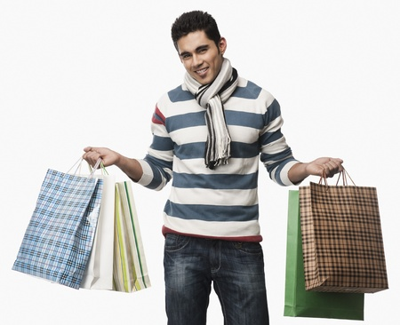 Portrait of a man carrying shopping bags Stock Photo - 10168281