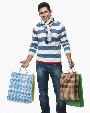 retail therapy: Portrait of a man carrying shopping bags LANG_EVOIMAGES