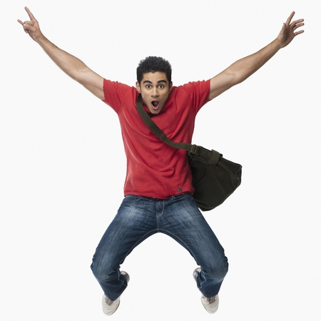 indian student: University student jumping in excitement LANG_EVOIMAGES