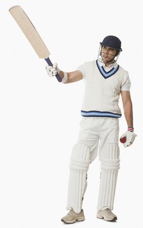 cricket ball: Cricket player showing his bat