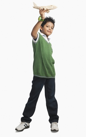 Portrait of a boy playing with a toy airplane Stock Photo - 10168972