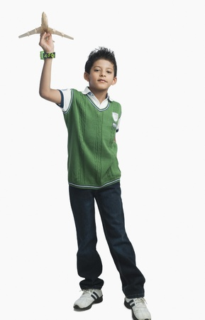 Portrait of a boy playing with a toy airplane Stock Photo - 10168941