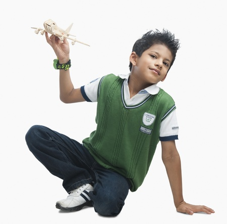Portrait of a boy playing with a toy airplane Stock Photo - 10167003