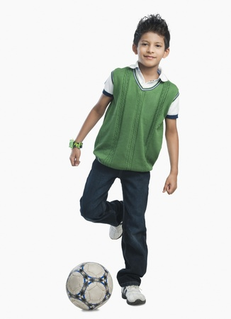 Portrait of a boy playing with a soccer ball Imagens