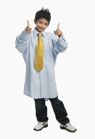 Boy dressed as a businessman and pointing gun sign Stock Photo - 10168923