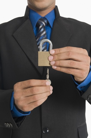 Real estate agent inserting a key in a lock Stock Photo - 10167557