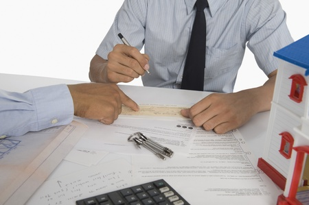 Real estate agent discussing a document with a customer Stock Photo - 10168296