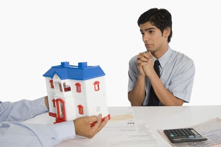 Customer pleading to a real estate agent Stock Photo - 10167039