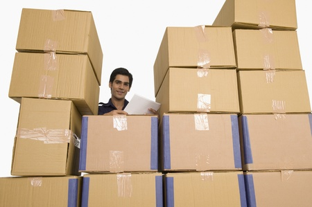 Store incharge with cardboard boxes