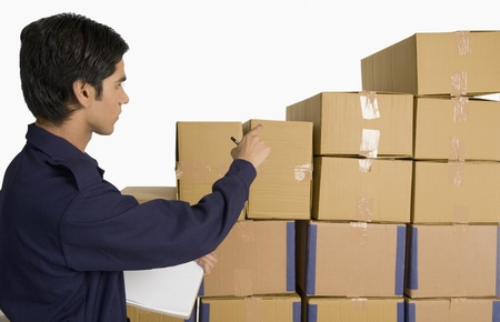 gurgaon: Store incharge counting cardboard boxes