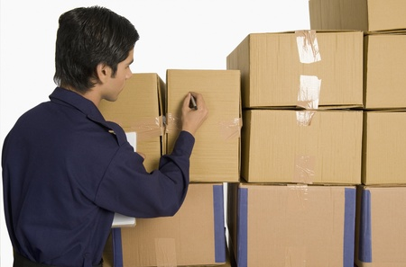 store incharge: Store incharge counting cardboard boxes