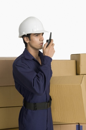 Store incharge on a walkie-talkie Reklamní fotografie