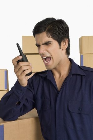 store incharge: Store incharge shouting on a walkie-talkie