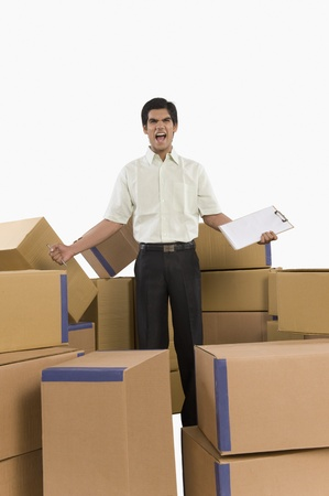 Store incharge standing among cardboard boxes and shouting Stock Photo - 10167167