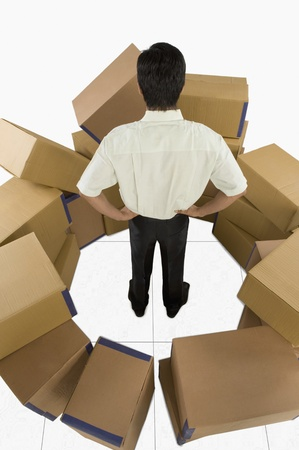 Store incharge surrounded by cardboard boxes Stock Photo - 10168334