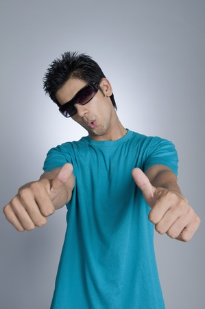 Close-up of a man showing thumbs up Stock Photo - 10168025