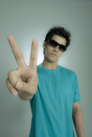 Close-up of a man showing peace sign Stock Photo - 10167082