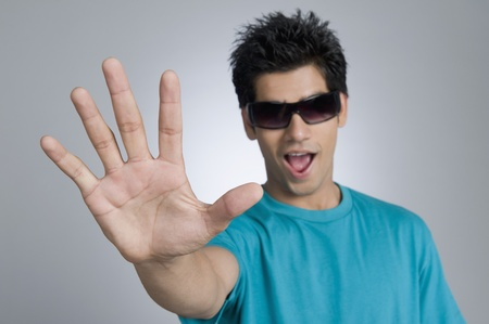 Close-up of a man showing stop gesture