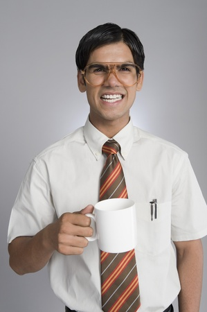 Man frowning over a coffee cup Stock Photo - 10167601