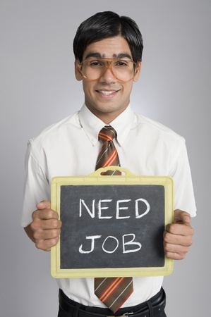 looking for job: Man holding a slate
