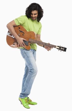 Close-up of a man playing a guitar
