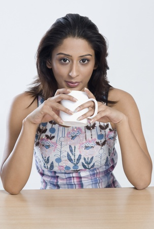 Woman drinking coffee Stock Photo - 10168019