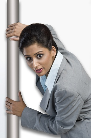 Woman hiding behind a door Stock Photo - 10168089